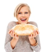 16610109-happy-young-woman-holding-a-fresh-loaf-of-bread